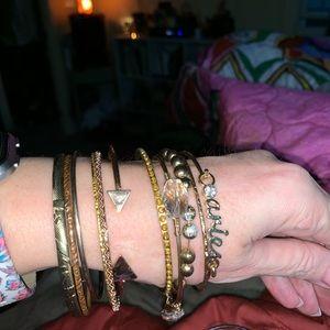 Jewelry - 11 (eleven) gold tone bracelets.